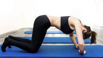 Mujer haciendo ejercicios hipopresivos