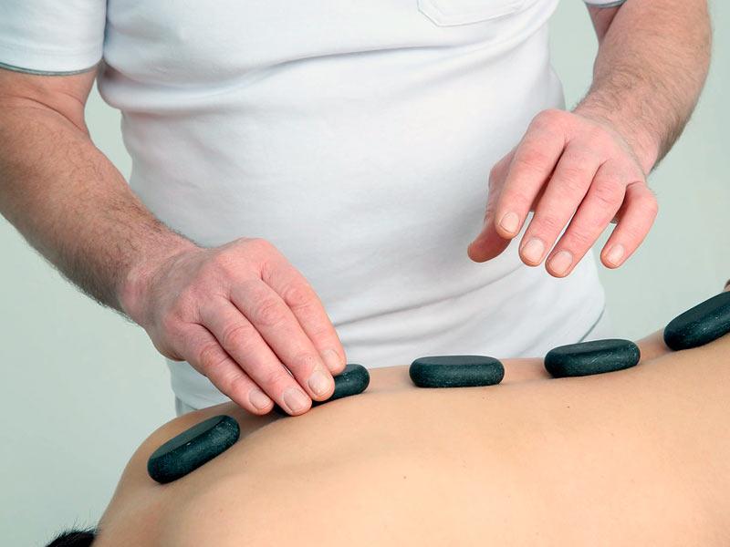 Qué es el masaje con piedras calientes 1