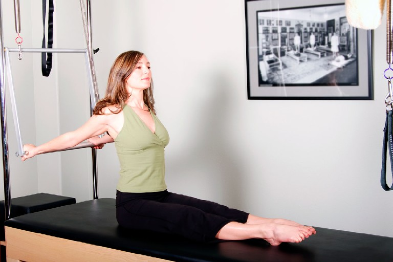 Instructor de Pilates máquina Reformer
